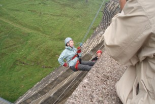 Woman abseiling down a wall