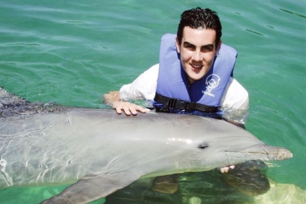 Ben Williamson swimming with dolphins