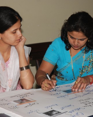 Two teachers participate in a Teacher Training workshop in Delhi, India.