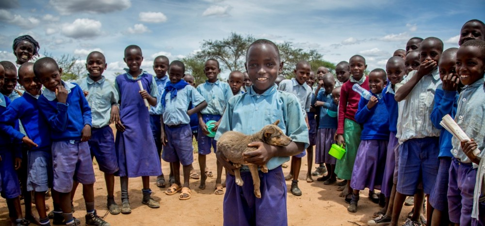 Child with dogs in Kenya