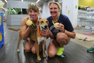Athena the dog with two Olympic gold medallists at our dog adoption event in Rio