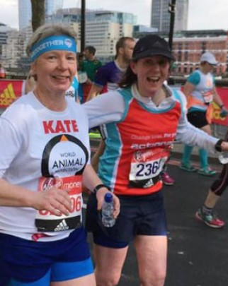A couple of supporters running the London Marathon