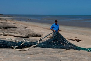 World Animal Protection team members on Gulf of Carpentaria with long fishing net.