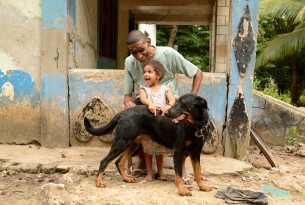 A man and his granddaughter with their vaccinated dog