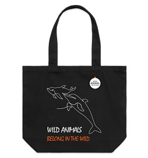 Black shoulder tote bag with dolphin line drawing.