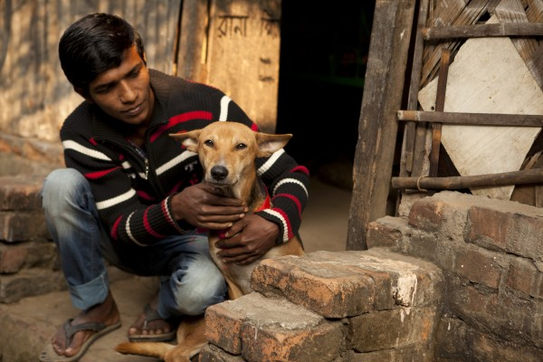 Mohammed Shoagh pictured with his dog Bullet who has just been vaccinated against rabies.