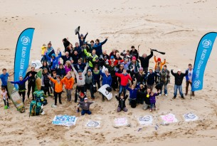 People taking part in a beach clean