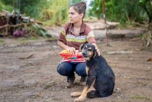 Woman with dog in Costa Rica after Hurricane Otto - World Animal Protection