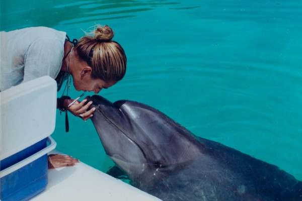 Makaiko the dolphin with former trainer Lorena Kya Lopez - World Animal Protection