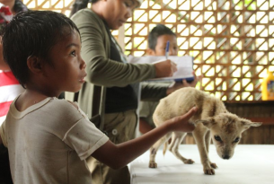 Child holding puppy - Philippines