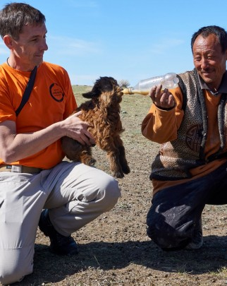 Steven Clegg from our disaster team feeding a baby goat in Mongolia.
