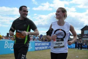 A woman with a World Animal Protection chatting to a man she's running next to