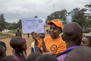Dr. Emily Mudoga, Animal Companion Campaign Manager, educates a group of local children on how to safely handle animals in the Kibera slum town Nairobi, Kenya. Credit Line: World Animal Protection