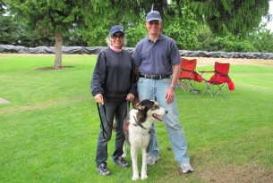 Kent and Diane W. of Washington State with their malamute/shepherd mix - a rescued dog