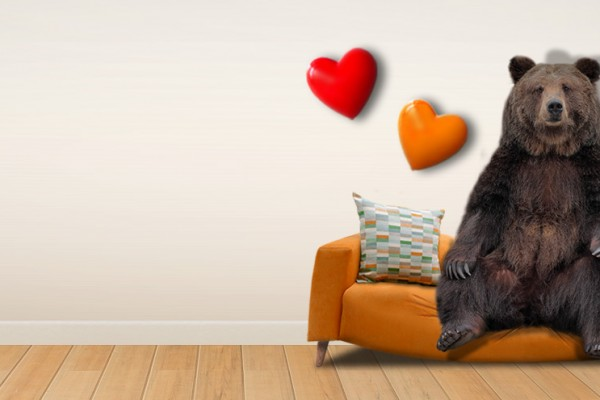 Simulated picture of a bear appearing to sit on a sofa, which bends under his weight