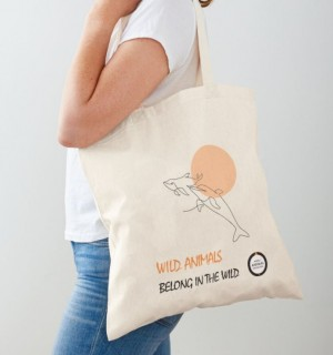 Tote bag with dolphin line drawing.