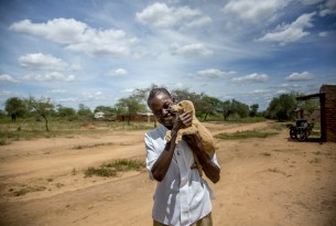 Man holding his dog in Kenya