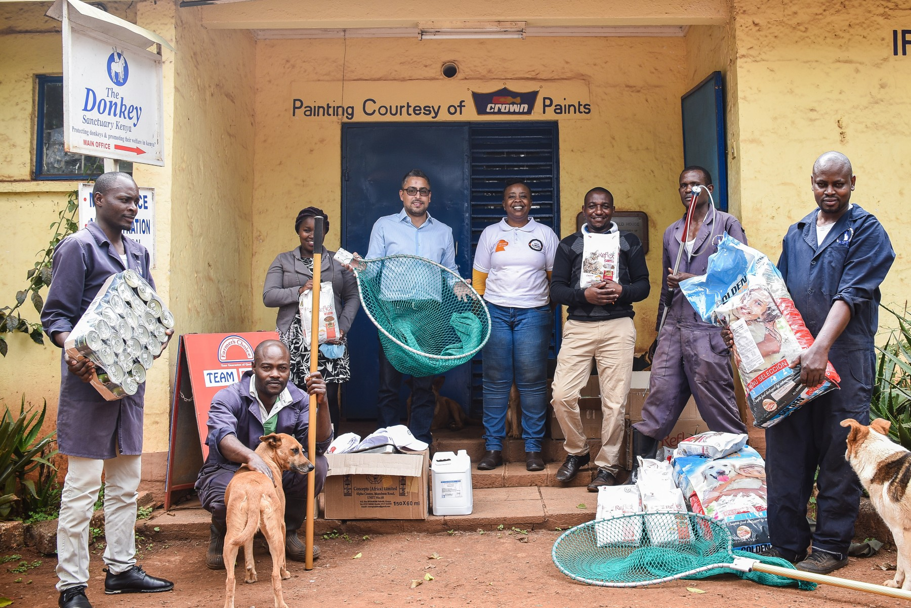 Emily Mudoga (Companion Animal Campaign Manager) giving World Animal Protection donations to the Kenya Society for the Protection and Care of Animals.