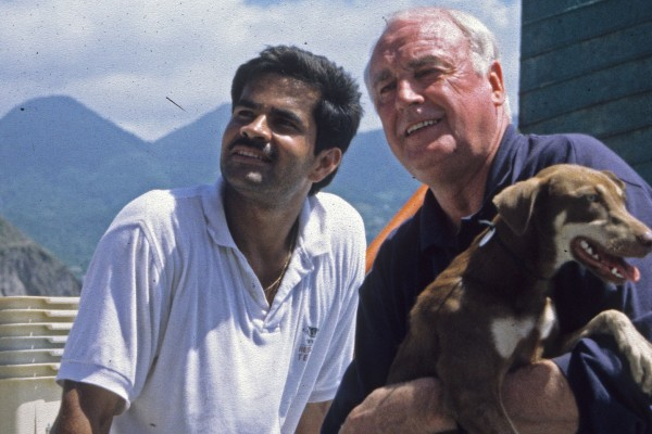 Gerardo Huertas and John Walsh pictured (circa 1980s) with a rescued dog